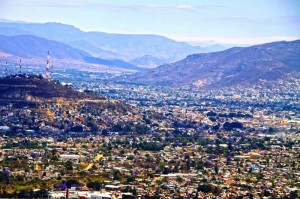 The Zapotec site of Atzompa is on a hilltop overlooking the present day city Oaxaca de Juárez on an adjacent hill to the